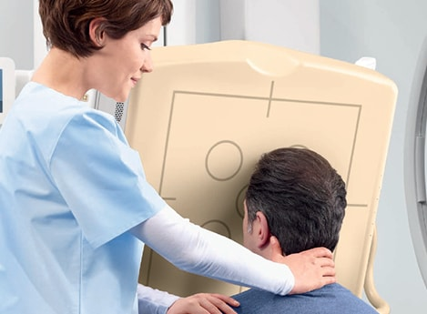 Head xray nurse helping patient