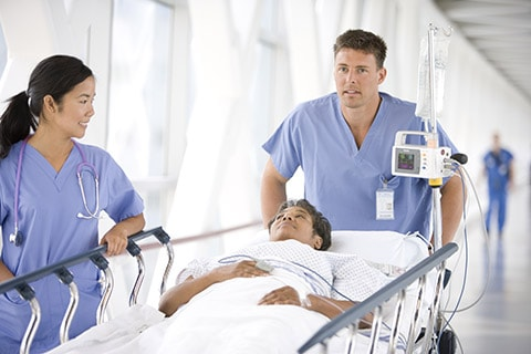 A patient is being wheeled in. Workflow adjustmenst can help  in reducing the risk of HAI